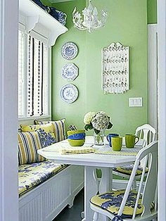 The window seat is used here to add further seating for guest in this apartment dining room. Decorated in shabby chic blending Light Room Colors green and blue . - Love the color palette. Banquette Design, Kitchen Banquette, Dining Nook, Kitchen Nook, Eat In Kitchen, Banquette Bench, Kitchen Chairs, Green Kitchen, Nook Table