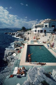 Guests round the swimming pool at the Hotel du Cap Eden-Roc, Antibes, France, August 1976. *The canvas prints arrive without frame, giving the photograph a modern gallery look, also produced by the mu