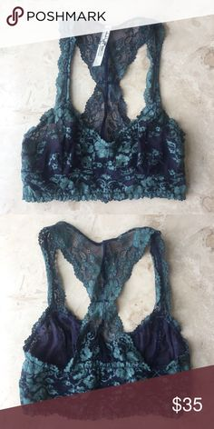 f31fe4158e248 Free People Lace Bralette Beautiful Emerald green and dark blue lace  bralette. Never worn.