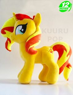My Little Pony Sunset Shimmer Plush New in store - the gorgeous Sunset Shimmer! The Equestria Girls character is resplendent in her pony form, with a fiery mane and tail. - Plush is approx 12 inches / 30 cm tall. - Brand new with tags. - Ages 6 & up.