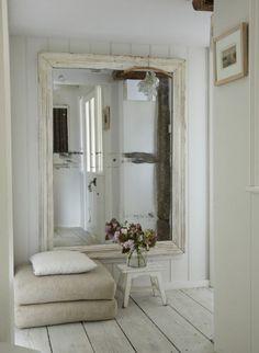 neutrals, oversized mirror + wide floorboards