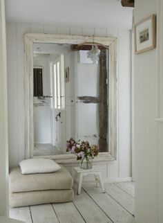 neutrals, oversized mirror + wide floorboards