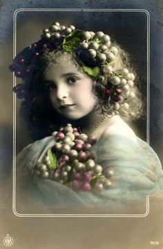 Early 1900's Pretty little girls from Antique tinted photographs.Bird cages, grapes, bunches of flowers and a parasol are featured