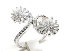 Twisted  Diamond Ring with Two Beautifully Crafted Flowers on each end in 18 K White Gold