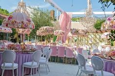 A truss structure was built overhead to support the chandeliers.  Soft pink chiffon fabric was draped at the corners and softened the structure.  Our White Venice Dining chairs enhanced the parasol table designs! (Planner: @alianaevents Rentals/Design: @revelryeventdesign Florist: @celiosdesign Table Top Rentals: @casadeperrin @cmcevents. Photographer: @klkphotography)