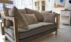 We're loving Nightwood's meadow loveseat from reclaimed spruce, pine, oak with mixed hand dyed linens and flax linen cushions.