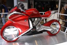 Honda a motorcycle, which was presented in 2008 at a bike show in Germany, is a stylish futuristic sport bike which is a bit against the generally accepted ideas about bikes. It offers a completely new design direction for the brand Honda. Concept Motorcycles, Honda Motorcycles, Custom Motorcycles, Futuristic Motorcycle, Motorcycle Manufacturers, Hot Bikes, Cute Cars, Super Bikes, Street Bikes