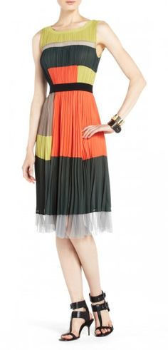 """$180.00A Bauhaus-inspired geometric color-blocked motif brings wear-everywhere appeal to this pretty pleated dress. Round neck. Sleeveless. Classic fit.Color-blocked construction. Allover pleating. Elastic at waist. Sheer tulle trim at hem.Measures approximately 43"""" from shoulder to hem.Sateen: Polyester. Mesh: Polyester. Lining: Polyester.Imported. Hand Wash."""