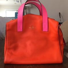 Kate spade medium tote bag Handles are a bit worn off and some minor leather damage. See pictures. Perfect bag for summer! kate spade Bags Totes