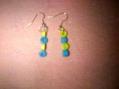 paper quilling earrings :    Lemon yellow and blue earring . Its is a simple...