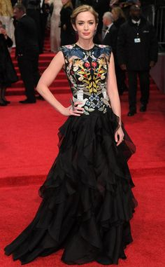 Emily Blunt from 2017 BAFTA Film Awards: Red Carpet Arrivals  TheGirl on the Trainnominee looks fierce in an animal-printed gown.