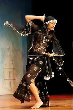 Dancer in assuit gawhazee dress