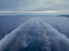 Wake behind a ferry by Photographer Christian B - Stocksy United Sky Sunset, Blue Rain, Waves, The Unit, Weather, Christian, Stock Photos, Outdoor, Outdoors
