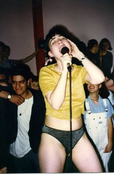 Kathleen Hanna. http://www.dazeddigital.com/music/article/16724/1/dazed93-bikini-kill