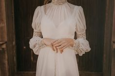 Victorian-inspired high neck wedding dress with lace sleeces