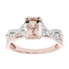 Fall in love with this great alternative to the traditional ring. The engagement ring features a cushion cut morganite center with lovely hues of soft pink. The 14k rose gold and rows of dazzling diamonds complement this beautiful look.