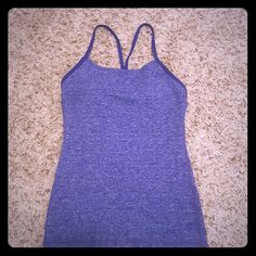 Lululemon Exercise Top Exercise Top with razorback straps Body: 45% Polyester 42% Nylon 13% Spandex. Lining: 87% Nylon 13% Spandex.  This top is soo comfy and so flattering! It is a size 4 and the material is so soft!! :) There are padded cups on the inside and support band. No need to wear bra with this top! :) Wore this top once. It no longer fits me post baby. lululemon athletica Tops Tank Tops