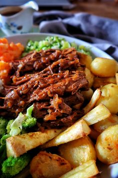 Slow-cooker beef brisket with rich onion gravy - I love beef, and particularly when it is slow-cooked- that tender, fall apart texture can't be be -