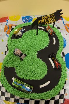 This was done in a race theme, but could use the same general idea for a Disney Cars theme with the Cars cars. The 3 is perfect for his 3rd birthday.