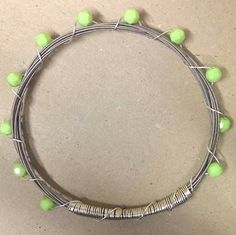 Silver Guitar String Bracelet with Lime Beads.