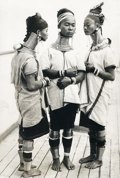 "Three Burmese women,members of a circus, wear the brass neck and leg rings traditionally worn by Padaung women since childhood and which cannot be removed, New York c. Women in Some African countries also wear ""necklaces"" similar to these."