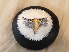 """Smooth river rock paperweight with a startling hand-painted image of a bald eagle's """"face"""". Excellent condition - no issues. Makes a great conversation piece for the desk or den. Measures approx 4 1/2"""" x 4 1/4"""" x 2"""".   eBay!"""