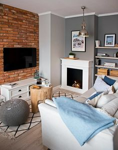 Grey wall with white furniture and wooden accessories Living Etc, Home And Living, Dream Apartment, Apartment Interior, Boho Deco, Brick Interior, Interior Design Companies, Design Interior, Cozy Living Rooms