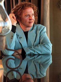 Mick Hucknall - lead singer of band Simply Red, sporting red dreadlocks.