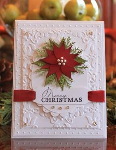 Wonderful embossing and layering on this elegant card.  Use quilling technique too.
