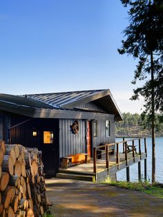 boat house with black exterior , lake house, dock