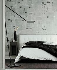black and white with newspaper print walls