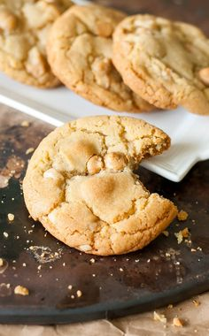 The best Peanut Butter Macadamia Nut White Chocolate Cookies of my life! Crunchy edges, a soft and chewy center, and loaded with melty peanut butter chips!