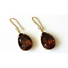 Swarovski Dark Topaz Crystal Drop Earrings Swarovski Rhinestone... ($28) ❤ liked on Polyvore featuring jewelry, earrings, brown earrings, gold teardrop earrings, drop earrings, yellow gold drop earrings and topaz earrings