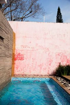 pool + old pink wall + outdoor architecture