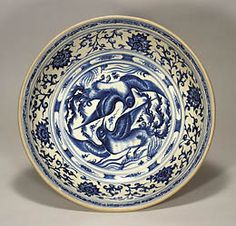 The Museum of Oriental Ceramics, Osaka. 'Example of Vietnamese blue-and-white ware extant in Japan. This design, with two sharp-beaked birds facing each other, is reminiscent of Chinese phoenix designs, but the overall impression is quite different. These birds have a wild power and intensity, along with an exhilarating sense of speed. The outstanding decoration of this dish has made it a world-famous masterpiece.'