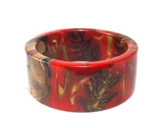 A personal favorite from my Etsy shop https://www.etsy.com/listing/260782312/bracelet-marble-red-gold-pine-cones-wood