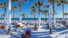 More of a beach club than a beach, Nikki Beach's Marbella outpost offers white day-beds, plenty of palm-trees, open-air fine-dining, live music and DJs in its outdoor restaurant. - Veranda.com