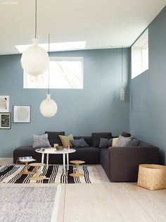 Plenty of seating in this modern minimalist living room. The large pendant lights help fill out the space created by the high ceilings. Nordic Living, Home And Living, Jotun Lady, Living Room Decor, Living Spaces, Of Wallpaper, Blue Walls, Home Decor Inspiration, House Colors