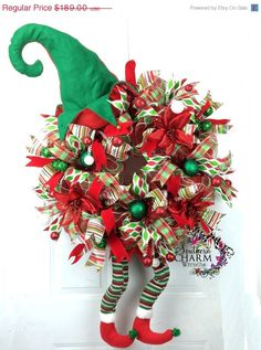 This whimsical Deco Mesh Elf Christmas Wreath will make your entry door festive and your guest ready for Christmas Cheer! The elf legs and