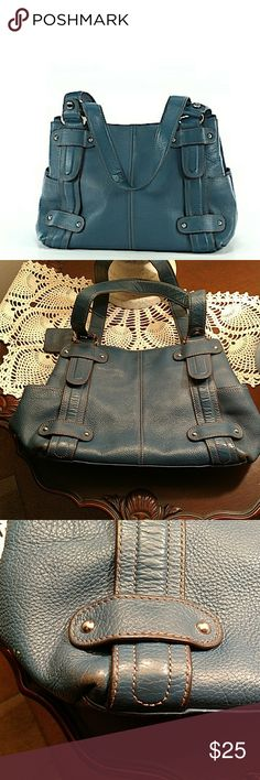 Beautiful Blue Tignanello Handbag Gorgeous wedgewood blue satchel purse. A few minor scuffs and stains, but otherwise good condition. There is a small ink spot inside  that was hard to capture. This purse has a ton of life left in it!  Top length is approximately 11 inches. Length at base is approximately 12 1/2 inches. Depth of bag is approximately 8 1/2  inches. Straps measure approximately 11 inches from top to bottom.  Feel free to make an offer! Tignanello Bags Satchels