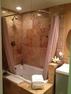 Shower + tub! master bath with jacuzzi... maybe a glass surround instead of shower curtain.