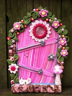 Daisies and Pinks fairy door pixie portal in polymer clay by pinkchihuahuacrafts