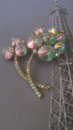 Vintage Brooch/Jewelry/Signed Weiss/Aurora Borealis/Rivoli Design/1950's/Mid-Century/Excellent Vintage Condition by LunasVintageDesigns on Etsy https://www.etsy.com/listing/249439566/vintage-broochjewelrysigned-weissaurora