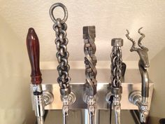My first attempts at hand forged beer tap handles.