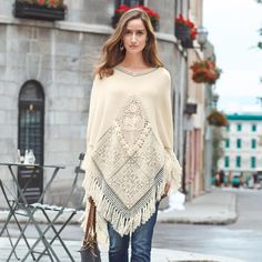 """POWDERHORN PONCHO--Our exquisitely cozy poncho offers mixed textures, with jacquard blocks, inset crochet and pleasingly chunky, knotted fringe. Easy-fit, pull-on style with double V-neckline. Viscose/nylon/merino wool/alpaca. Hand wash. Imported. Exclusive. Sizes XS/S, M/L, XL. Approx. 30""""L at longest point."""