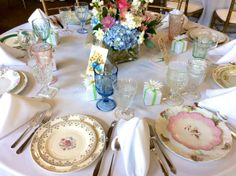 Gorgeous mixed and matched vintage place settings at wedding reception