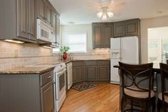 From old and worn 20 year old wood cabinets to a custom gray finish with black glaze. Refacing Kitchen Cabinets, Kitchen Cabinet Colors, Grey Cabinets, Kitchen Reno, Kitchen And Bath, Kitchen Dining, Kitchen Remodel, Kitchen Stuff, Dining Rooms
