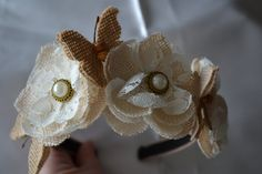 Gold satin hair band covered with three burlap flowers with pearl button centres. Four burlap butterflies dance between the flowers. Perfect for a flower girl or just for a dressy accessory. Burlap Flowers, Hair Band, Butterflies, Special Occasion, Satin, Brooch, Dance, Pearls, Button
