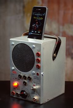 ipod iphone charging station with speakers from vintage radio test equipment - would be a fun to have this in my ham shack to charge my iPhone while I'm down there.