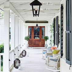 A 113-foot-long breezeway leads to the mahogany Shaker-style front door of this Lowcountry house.